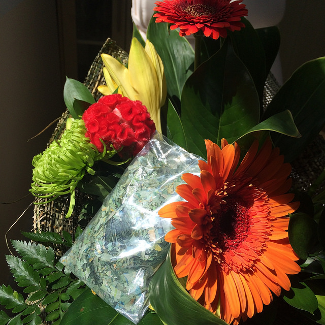 Gifts for 76th birthday: flowers and shredded dollar s